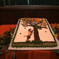 Ut Groom's Cake - Get Em Smokey Orange/white marble cake, grand marnier buttercream base icing, mascots are flood icing pieces, leaves, tree, and border are buttercream.