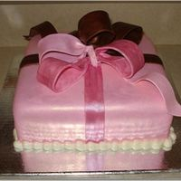 Pink And Brown Present Almond butter cake, almond buttercream underneath fondant, bow is gumpaste, pearl border is fondant, dark pink ribbon is painted with...