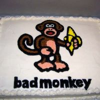 Bad Monkey White cake, all decorations in buttercream, I printed a mirror image of the design then used a clear piping gel transfer as guide for the...