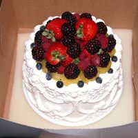 Top Tier trifle cake with stabilized whipped cream icing and fresh fruit