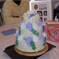 Wisteria, Lilly Of The Valley And Roses This was the 3rd cake I ever made. Its a non-crusting cream cheese icing with fondant lilly of the valley and roses.