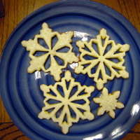 Snowflake Cookies all butter sugar cookie with royal icing and sugar crystals.