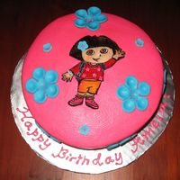 Dora Cake buttercream cake with fondant flowers and painted dora on sugarpaste