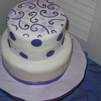 Playful Purple Birthday Cake   Two layers of Rich Butter Cake filled with Meringue Buttercream. Covered in fondant and royal icing. My first fondant cake!