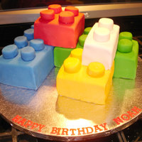 Lego Cake This was fun to make. The little round dots on top are big marshmallows cut in half and covered in fondant.