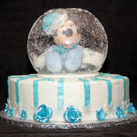 "Winter Minnie Mouse In A Snow Globe Baby's first birthday cake. 12"" yellow cake with butter cream frosting. Fondant flowers, stripes, and snowflakes that were..."