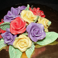 Chocolate Rose Cake Topper Roses and leaves are made out of modeling chocolate. Dusted everything with luster dust.