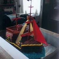 Pirate Ship Vanilla cake with buttercream icing. I used a pirate ship kit for the plastics, first time using that type of kit and it worked well....