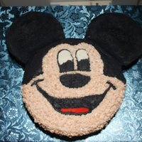 "Mickey Mouse   Not my best work but a lot better than my first. The head is a 9"" yellow cake and the ears are 6"" cookies and cream cakes."