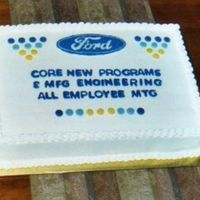 "Corporate Cake Ford logo is a FBCT. 1/2 white cake, 1/2 chocolate. Had a heck of a time coming up with a design for this. Wanted it to look ""..."