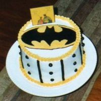 "Batman Emblem WASC w/pineapple filling. Emblem is a FBCT. Picture of Robin & Batman made of cardstock. Says ""Holy Cakes Batman - it's Bleu..."