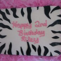 Zebra Stiped Made this for a friend's daughter for her second birthday. BC with gumpastes zebra stripes and pink feather boa around the board. She...