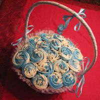 Wedding Cupcake Bouquet In Light Blue This was made for another friend and her wedding colors are going to be light blue and brown. I put light blue swirls and chocolate...