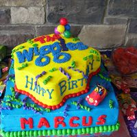 The Wiggles This was for my sons 2nd birthday. 16inch & 14inch shaped, fondant accents, bought the wiggles cake kit from Walmart, iced in...