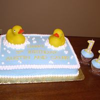 Rubber Duckie Cake This is a 1/4 sheet cake with a rubber duckie theme for twin one year old boys who love bathtime. Two cupcakes were also made with their &...