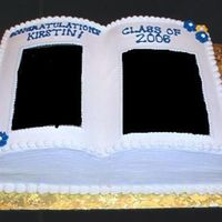 Graduation Book Cake This is a graduation cake I did recently (photos are blacked out for purposes of posting here). The left side had a baby picture and the...