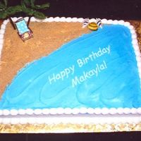 Beach Cake Marble cake with buttercream icing. I used crushed graham crackers for the sand. Royal icing seashells. The beach chair and palm trees were...