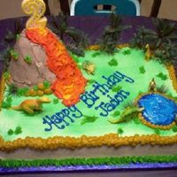 Dinosaur Theme I made this cake for my sons 2nd birthday. We put the candle on top of the volcano