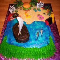 "Buffet Paradise Cake cut out in the shape of a ""Parrot Head"", has refrences to several songs including: Cheeseburger in Paradise, Pirate looks at..."