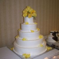 June Wedding This 5 tier cake was done in butter cream icing and accented with fresh flowers.