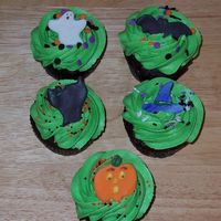 Halloween Cupcakes Cupcakes I made for my husband to take to work. The decorations are candy clay cutouts with candy melt features.