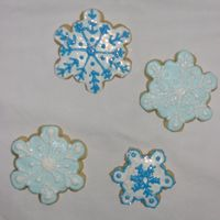 Snowflake Cookies No fail sugar cookies with royal icing and a sprinkle of disco dust.