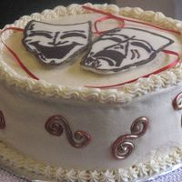Red Velvet Birthday Cake For A 16 Year Old Girl The cake is a 4 layer red velvet cake with ivory cream cheese frosting. The masks on top are chocolate relief designs and the scrolls on...