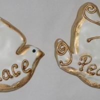 Doves Dove cookies with royal icing and gold dust brushed on.