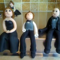 Wedding Party Figures Made these for a friend's wedding cake. My first attempt at creating figures using aine2's wonderful tutorial. They have no teeth...