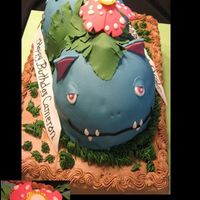 Pokemon Venusaur Birthday Cake My son loves Pokemon and wanted this for his 9th birthday. Base is Dark Choclate Fudge filled with chocolate pudding with chocolate icing....