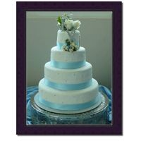 Blue & Silver very simple covered in fondant with silver edible pearls and a blue ribbon.