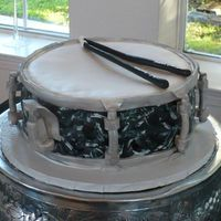 Guyton's Snare Here was the groom's cake for a professional drummer - the black/white detailing on the side resembled his favorite snare. I added the...