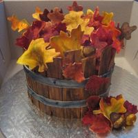 Bucket Of Leaves  I donated this cake for a fundraiser in memory of a friend of my sisters, who passed away from Lung Cancer. It is a Red velvet cake with...