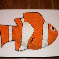 Nemo Used the football pan for his body. Fins and tail drawn with buttercream onto the cake board.