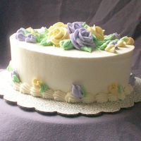 Purple And Yello Roses Buttercream icing. Just some practice. :o)