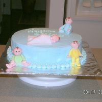 Tara's Shower Cake Buttercream icing with fondant babies