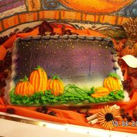 Twilight Pumpkin Patch Buttercream icing. background airbrused with edible paints. Pumpkins done with buttercream.