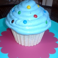 Giant Cupcake Made this with my 9 year old, because she loves cupcakes. New Wilton confetti candy melts for shell.