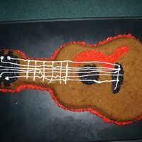 Father's Day Guitar This is a giant peanut butter cookie made by my 8 year old daughter and decorated by her and her 11 year old sister. They made it for...