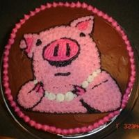 Pig Cake This pig cake was for my pig-loving daughter's ninth birthday. It has PIG written in different languages all around the sides.