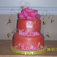 Welcome Home This is made with mmf and bc, dible sparkle dust for shine, and small floral wire w/ fondant hearts.I designed it for my 15 year old cousin...