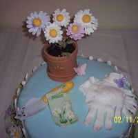 "Gardener's Birthday This was designed for my Aunt Nita's 50th birthday. It was my third fondant/gp cake. I used the large 15"" petal pan and took the..."