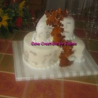 Fall Commitment Cake Covered in fondant with fondant leaves