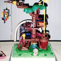 Caillou Tree House   Use of Caillou's Treehouse Surprise present used as cake decoration. Created slab cake as park setting.