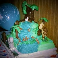 "Side View Of Jungle Cake Large tree and rocks are candy clay, ""leaves"" on large tree broke in route to event site. Palm trees are fancy cookies covered in..."