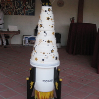 Rocket Wedding Cake Cakes are chocolate, french vanilla, lemon and red velvet. Fondant covered.Very challenging!