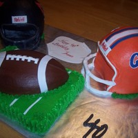 Football Helmets   helmets carved in choco cake, vanilla cake for football and field...all buttercream, with fondant/gumpaste accents.