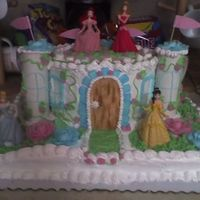 Disney Princess This is a full triple chocolate fudge sheet cake. The round cake is white all buttercream. The door and the leaves are MMF colored by hand...