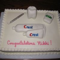 Dental Hygienist Graduation Cake For a gal who graduated from dental hygiene school. RK tooth, floss, and toothpaste. Covered in MMF. MMF covered lollipop stick for pick....