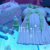 Baby Shower Cake All fondant....baby diaper bag, belly cake (belly and boobs are cake)...the figures are fondant too